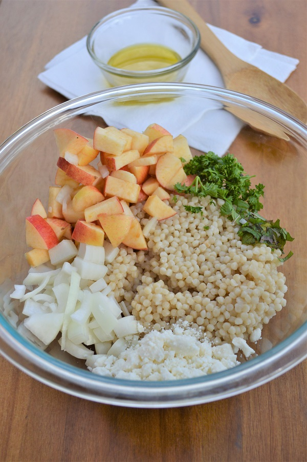 A delicious and refreshing salad made with Israeli couscous, apples, fresh herbs and a lemon vinaigrette.